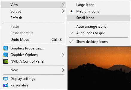 Right-click on the desktop then select View and change the view from your currently selected view to any other