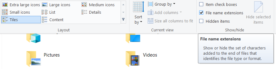 Click on View tab and checkmark File name extensions