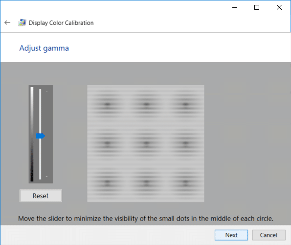 Adjust the gamma settings by moving the slider up or down until the visibility of small dots in the middle of each circle is minimum