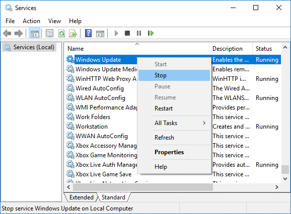 Right-click on Windows Update service and select Stop