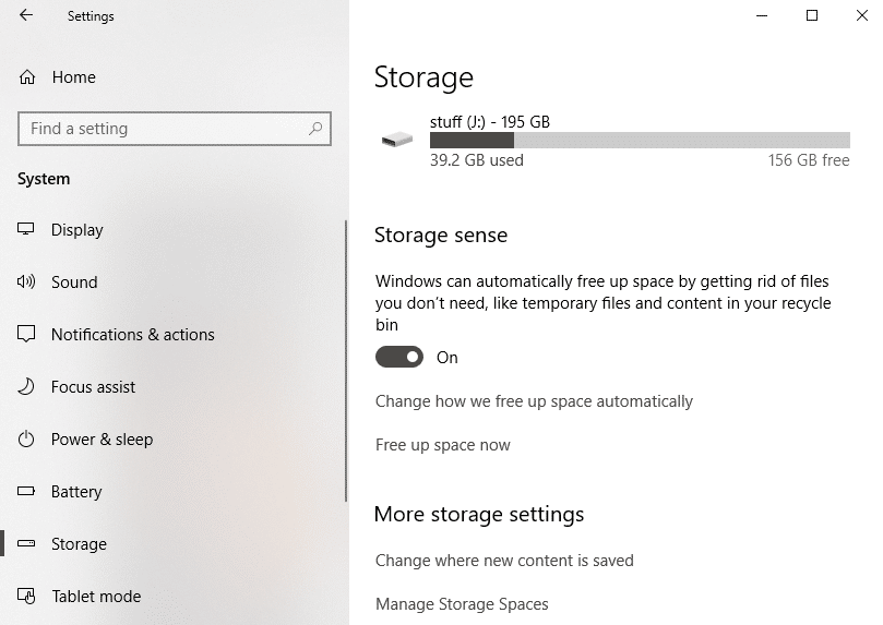 Select Storage from the left pane and scroll down to Storage Sense