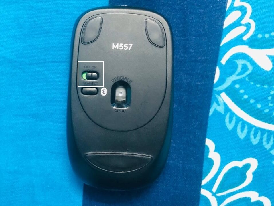 Slide the power switch at the bottom of the mouse to ON position
