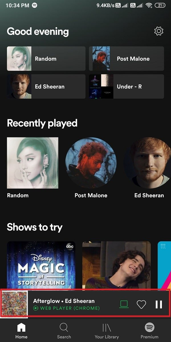 Play any random song and tap on the currently playing song | How To Clear Queue In Spotify